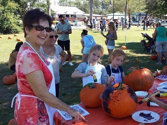 Children paint pumpkins at Bonita Spring's RiverFest.