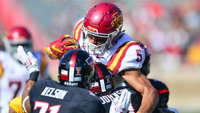 Allen Lazard fights for yardage during Saturday's game against Texas Tech.