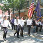 Participants march down Main Street during the Annual Memorial Day Parade in Nyack May 28, 2012. ( Matthew Brown / The Journal News )