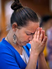 Sister Tracey Horan prays at Christ Cathedral, during