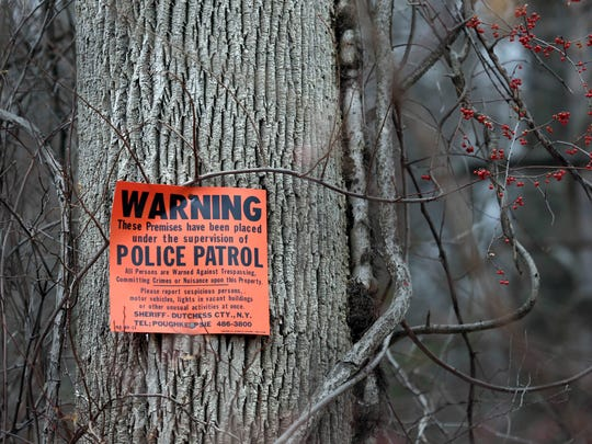 In this Feb. 1, 2018, photo, signs warning of police