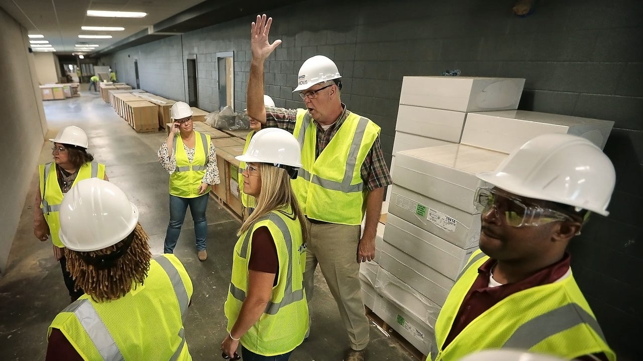 Principals and staff from the Collierville School District tour the new $94 million high school that is slated to open in August 2018.
