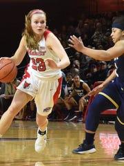 Marist College's Rebekah Hand drives the lane against Navy at McCann Arena in Poughkeepsie last season.