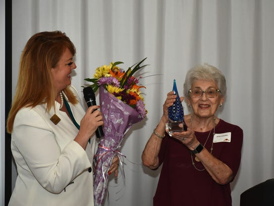 Myra Shapiro, right, is presented with the first Myra