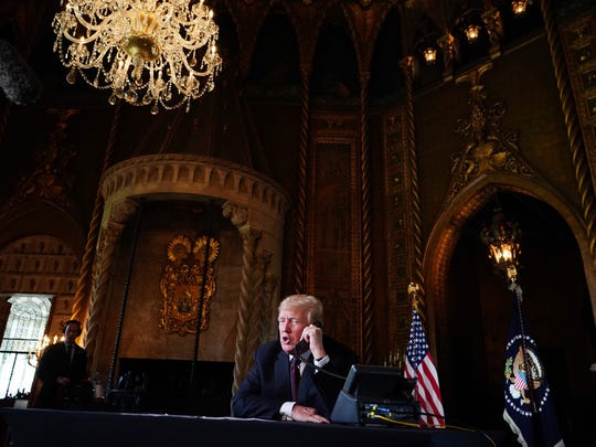 US President Donald Trump speaks to members of the