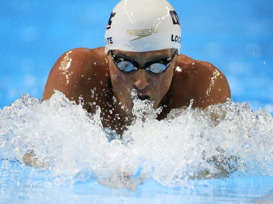 Ryan Lochte swims in the men's 200-meter individual medley preliminaries Thursday at the U.S. Olympic swimming trials in Omaha, Neb.