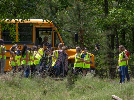 Manchester High School students visit the former Ciba-Giegy site to collect camera data as they study the deer population at the site.