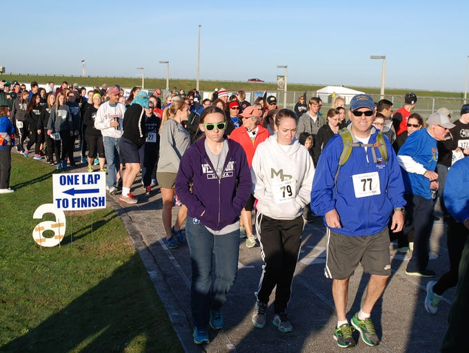 The walkers are off at the sound of the air horn during