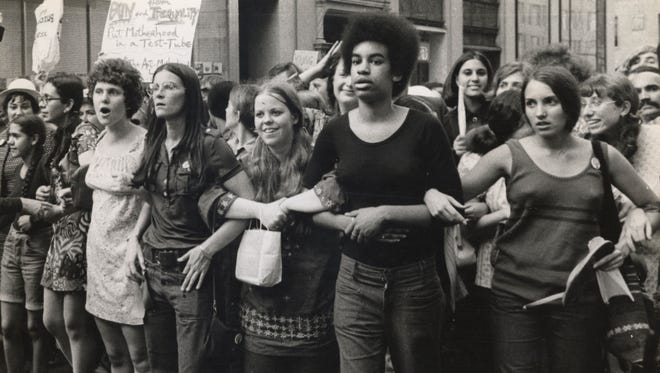 People march Aug. 26, 1970, to mark the 50-year anniversary of the 19th Amendment. It prohibited states from denying people the opportunity to vote based on their sex.