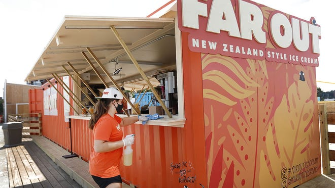 Far Out Ice Cream on Nantasket Beach is housed in a shipping container where they serve New Zealand-style ice cream, a choice of fruit flavors and house-made waffle cones. Employee Jennifer Kennedy cleans the counter during her shift.