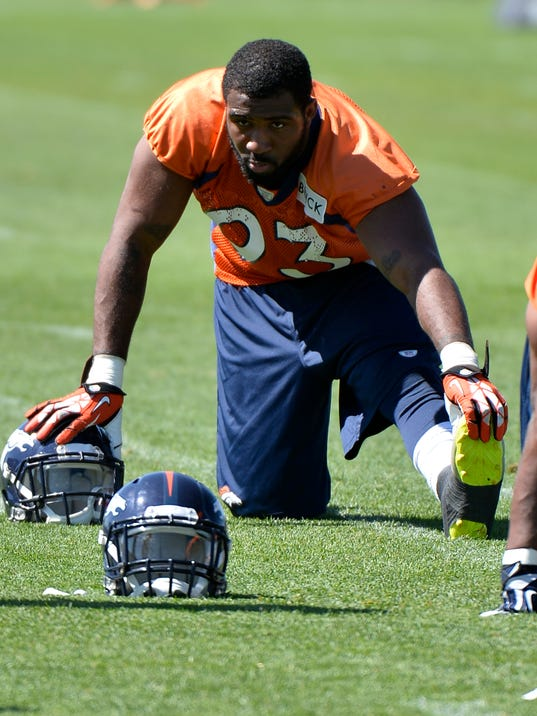 FILE - In this June 2, 2014, file phot0, Denver Broncos' Quanterus Smith stretches during an NFL football organized team activity in Englewood, Colo. Smith, a second-year pro from Western Kentucky who spent his rookie season on injured reserve, turned heads during the Broncos' offseason workouts, flashing the speed and skills like he showed on that three-sack day at Alabama that first put him on the NFL radar back in 2012. (AP Photo/Jack Dempsey, File)