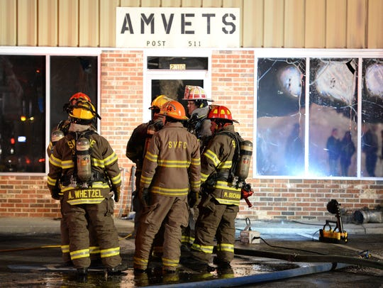Firefighters on the scene of a fire at the AMVETS Post