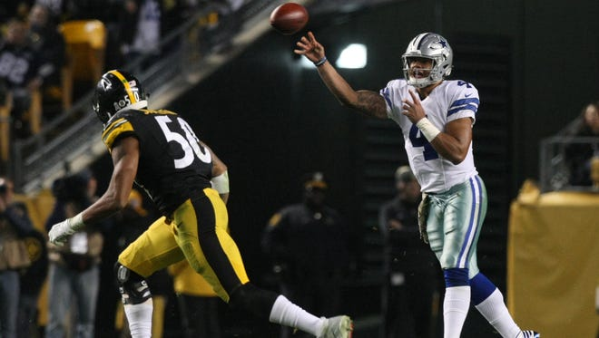 Dallas Cowboys quarterback Dak Prescott (4) throws a pass against Pittsburgh Steelers linebacker Ryan Shazier (50) during the second half of their game at Heinz Field. The Cowboys won the game, 35-30.