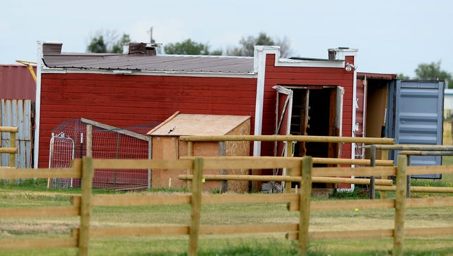 Red barn on the property at 5029 66th Ave. S.W. where the homicide investigation in the death Adam Petzack continued on Thursday. Brandon Lee Craft has been charged with homicide in the case.
