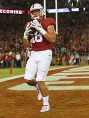 Stanford tight end Austin Hoopercatches a 4-yard touchdown pass against the UCLA Bruins.
