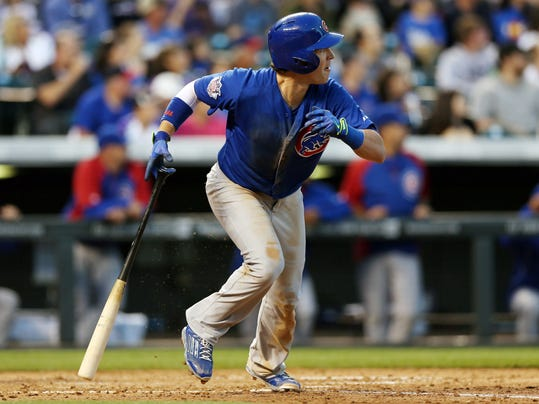 Chicago Cubs' Chris Coghlan follows the flight of his RBI-double against the Colorado Rockies in the fifth inning of a baseball game in Denver on Wednesday, Aug. 6, 2014. (AP Photo/David Zalubowski)