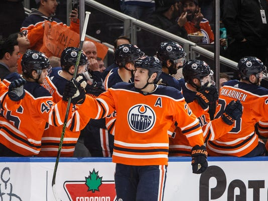 Edmonton Oilers' Milan Lucic (27) celebrates a goal against the Arizona Coyotes during first period NHL hockey action in Edmonton, Alberta, Monday, March 5, 2018. (Jason Franson/The Canadian Press via AP)