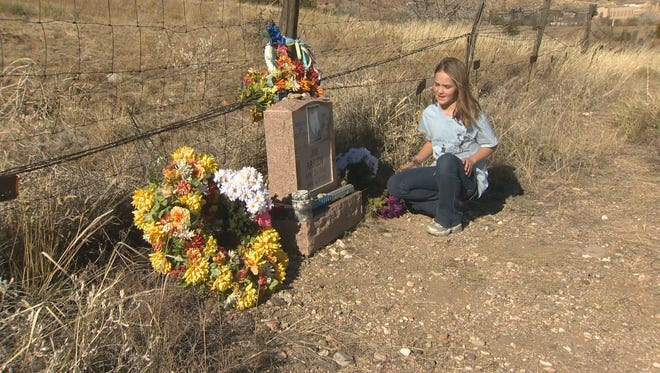 """10-year-old Jeweleen Reiter is helping place artificial color on the gravesites of the DOC inmates buried at Canon City's historic Greenwood Cemetery. """"These people, they were people like us, except for they did wrong and yeah, they did wrong so of course they're going to be punished, I don't think they should get this much of punishment,"""" Reiter said."""