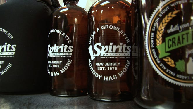 Brick, NJ 1/22/15.  The Beerkeeper investigates beer growlers at Spirits Unlimited. Staff photo by: Brian Johnston Asbury Park Press, Video available.
