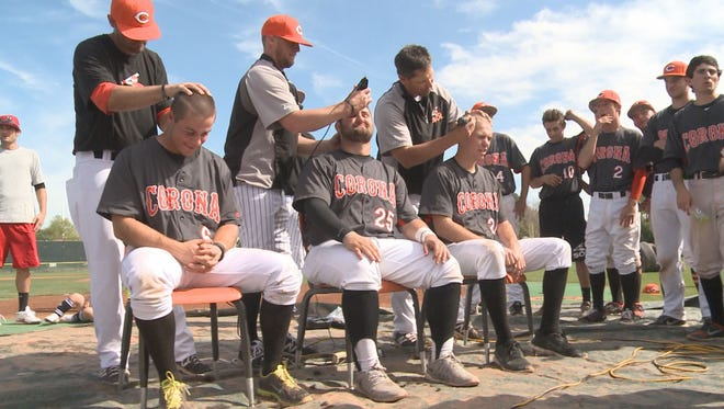 Coaches and players of the Corona del Sol High School baseball team shaved their heads on Saturday, Feb. 21 to raise $7,000 for the Children's Cancer Network and their classmate Ridge Vanderbur.