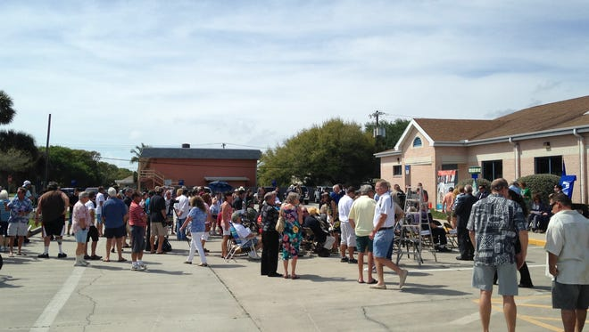Crowds attend the renaming of the Cocoa Beach post office.