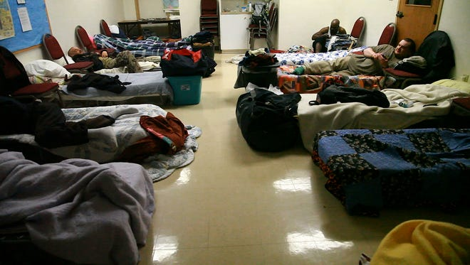 Men bed down Friday night in cots provided by Fishersville United Methodist Church, one of 16 churches in the WARM network providing shelter for Valley homeless people during the coldest months of the year.