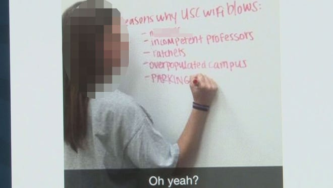 The image that was posted on social media showing the woman in front of the white board.