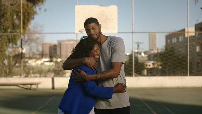 Indiana Pacers player Paul George hugs his mom, Paulette. She had a stroke at age 37 when George was six years old.