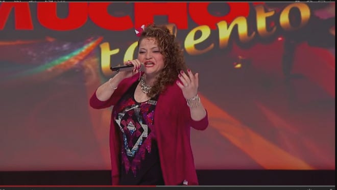 "Monica Salinas sings while performing on ""Tengo Talento, Mucho Talento."""