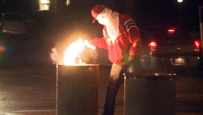 APRIL 28, 2015: A NewsChannel 5 photojournalist captured a protester lighting a dumpster on fire.