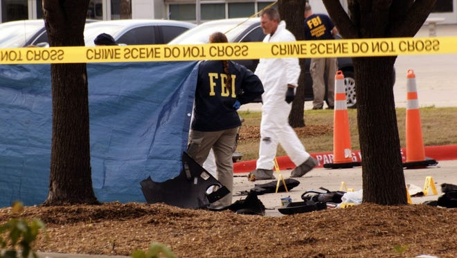 FBI agents view evidence at the Curtis Culwell Center on May 4, 2015, in Garland,Texas.