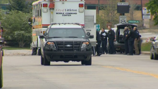 An FBI agent was shot in the leg while serving a warrant for a bank robbery suspect at a Littleton hotel Friday afternoon. The agent suffered non-life threatening injuries, according to Littleton police.