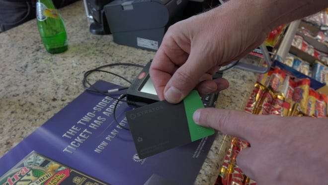 Paying with the Stratos all-in-one card.