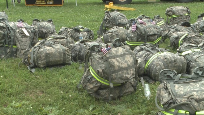 Rows of ruck sacks await veterans who participated in the '22 Challenge' to raise awareness of veteran suicide on May 16, 2015