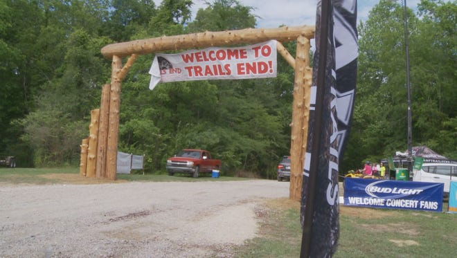 A man faces murder charges after driving his SUV through a crowd at Trails End Campground Saturday after the Trace Adkins concert.