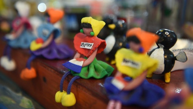 A souvenir sits in a Dominican Republic gift shop. A 2013 decision by the Dominican Republic's Supreme Court effectively stripped tens of thousands of people of their nationality retroactively, prompting some activists to call for a tourism and economic boycott of the Dominican Republic.