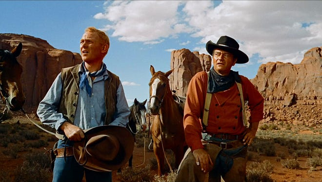 """Monument Valley provided a magnificent backdrop for Harry Carey Jr. (left) and John Wayne in """"The Searchers."""""""