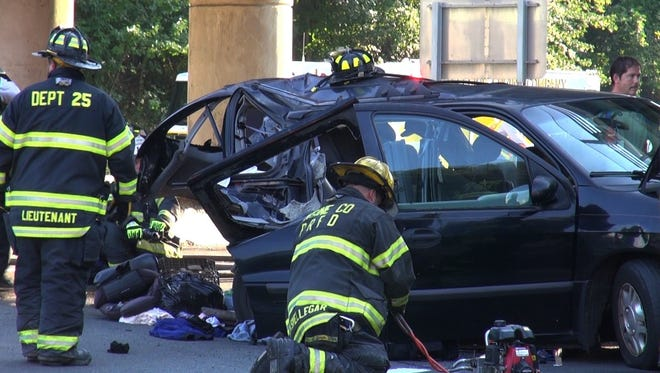 Crews work on extracting people out of a car that was involved in an accident on the New York State Thruway in Rockland.