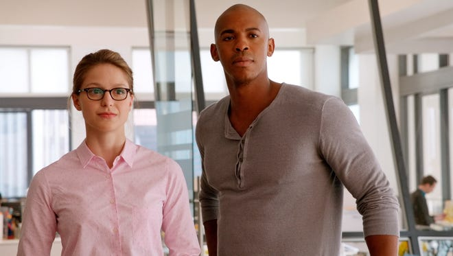 """This image provided by CBS/Warner Bros. Entertainment shows, Melissa Benoist, left, as Kara Zor-El, and, Mehcad Brooks as James Olsen, in a scene from the pilot for """"Supergirl,"""" debuting Monday, Oct. 26, 2015, 8:30-9:30 p.m., and will be broadcast in it's regular time period, Mondays 8:00-9:00 p.m. starting Monday, Nov. 2."""