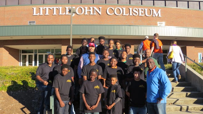 Members of the 100 Black Men of Upstate SC Greg Stephens (far left near rail), Carmichael Caldwell (blue jacket right front), Bradley Robinson (blue jacket back row), Tyrus Clark (blue jacket middle) and  Reggie Thomas (green shirt right middle) and their mentees at Clemson University..