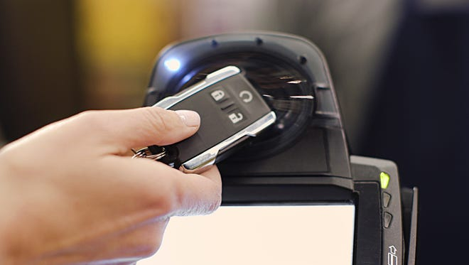 Through a partnership with MasterCard and GM, you might be able to pay with your key fob.