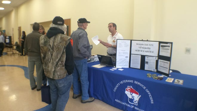 Wood County Veterans Services Officer Rock Larson talks to veterans about available services during a November 2014 Stand Down event at the Rapids Mall in Wisconsin Rapids. Another Stand Down will take place Thursday.