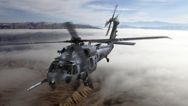 An artist's rendering of the combat rescue helicopter that will be built by Lockheed Martin and Sikorsky Aircraft. Lockheed announced this week that it will be trimming 350 workers from its Mission Systems and Training workforce.