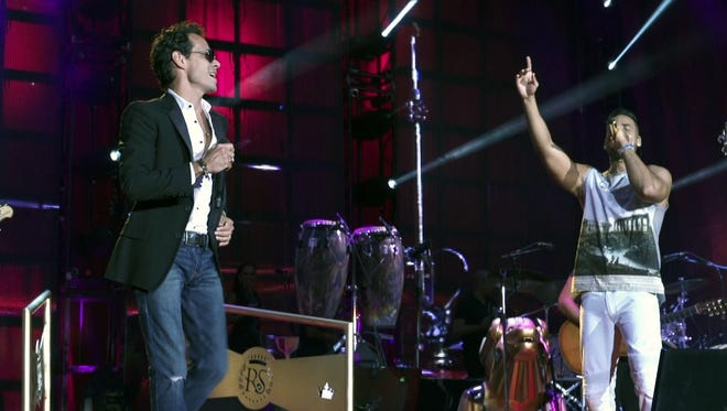 """Marc Anthony and Romeo Santos in a scene from """"The Latin Explosion: A New America."""""""