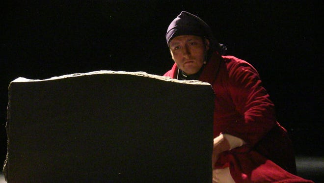 "Matthew Ross, as Ebenezer Scrooge, gazes at his own tombstone in Lakeview High School's ""A Christmas Carol."""