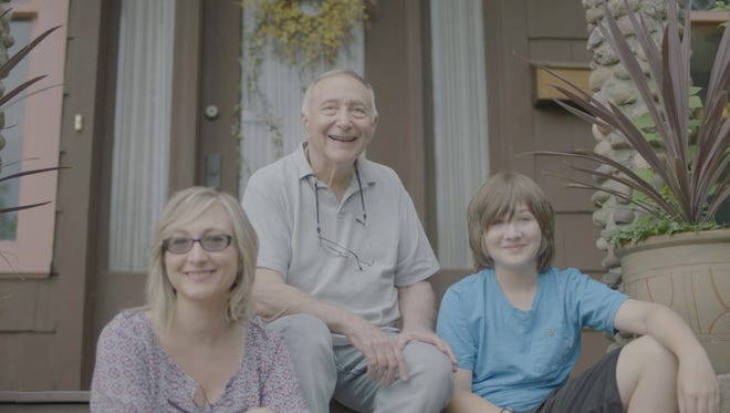 Simon Saltzman at his Chatham home with daughter Alice and grandson Ben.