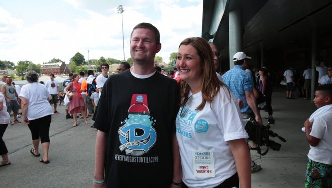 Pat and Jenn Quinn enjoy the crowds at Pat Quinn's Go 'All In' ALS Ice Bucket Challenge at Yonkers Raceway. Aug. 2, 2015. Quinn's alma mater, Iona Prep, will host a fundraiser for his Quinn for the Win foundation during Friday's basketball tripleheader with Christ the King.