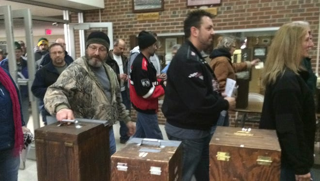 UAW Local 833 members cast votes on a new contract proposal Wednesday night.