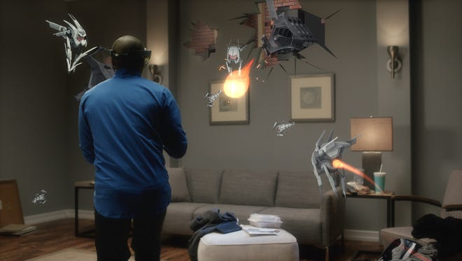 Fighting robot holograms in Project X-Ray game on Microsoft HoloLens