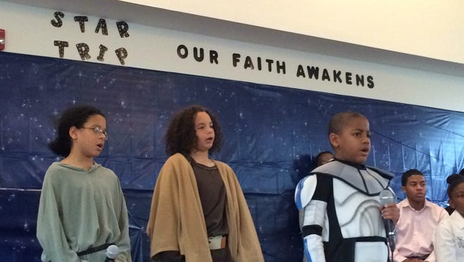 "Children perform in the Bethel AME church's Christmas pageant: ""Star Trip: Our Faith Awakens."" From left, Hosannah McKinney, Princeton McKinney and Michael Carl Hill."